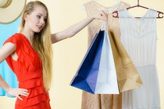 Woman in shop picking summer outfit Stock Photo