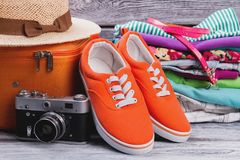Woman clothes with suitcase and vintage photo camera. royalty free stock image