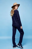 Woman clothes wool cashmere suit pants sweater dark blue color a Stock Image