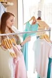 Woman in clothing department Stock Image