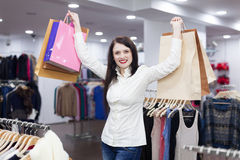 Woman at clothing shop Stock Images