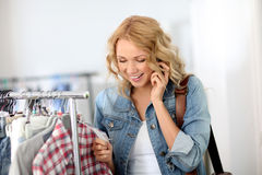 Woman in clothing store Stock Images