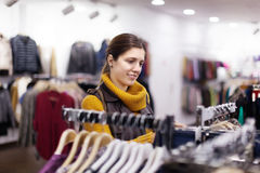Woman   at clothing store Royalty Free Stock Photo