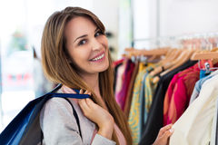 Woman in clothing store Stock Photography