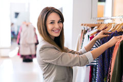 Woman in clothing store. Young woman in clothing store Royalty Free Stock Photo