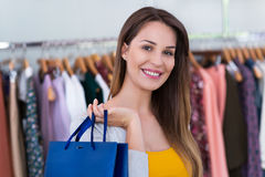 Woman in clothing store Royalty Free Stock Photography