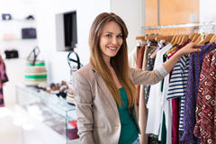 Woman in clothing store stock image