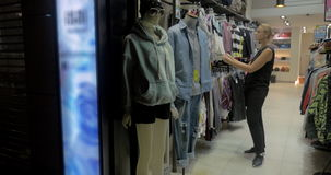 Woman in clothing store stock footage