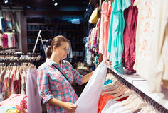 Woman in a clothing store Royalty Free Stock Images