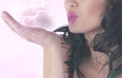Woman blowing fairy dust Royalty Free Stock Photos