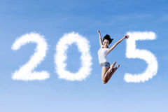 Woman with cloud forming number 2015 Stock Photo