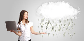 Woman with cloud and money rain concept Stock Photo
