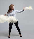 Woman with cloud and sun. Concept on the topic of computer cloud services. Stock Photo