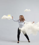 Woman with cloud and sun. Concept on the topic of computer cloud services. Stock Images