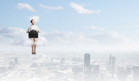 Woman on cloud Royalty Free Stock Photos