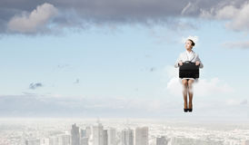 Woman on cloud Stock Images