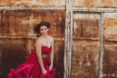 Woman in cloudy red dress, rustic style Royalty Free Stock Photography