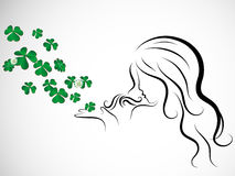Woman and clover Stock Image