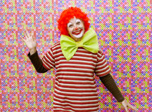 Woman clown with background color. Funny clown with makeup and party background color Royalty Free Stock Image