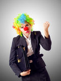 Woman clown. The woman clown in business suit Royalty Free Stock Images