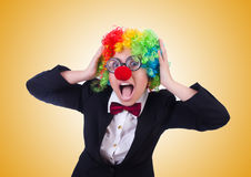 The woman clown businesswoman isolated on white Stock Photo
