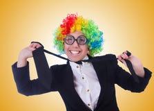Woman clown businesswoman isolated on white Stock Photos
