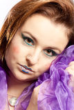 Woman with clown make-up. Imaginative made-up woman nestles in a cloth Stock Images