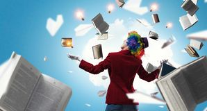 Juggling woman clown . Mixed media. Woman with clown make up wearing wig juggling items . Mixed media stock photography