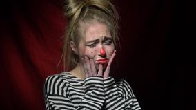 Woman clown shows that she is sad stock footage