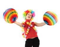 Woman in clown wig, flower garland and balls Royalty Free Stock Images