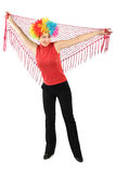 Woman in clown wig standing and holding red shawl Stock Photos