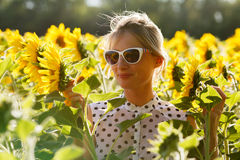 Woman clowns in the sunflowers Royalty Free Stock Photography