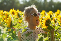 Woman clowns in the sunflowers Stock Photography