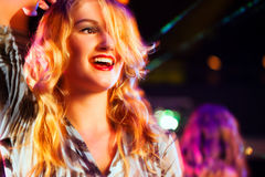 Woman in club or bar having fun Royalty Free Stock Images