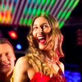 Woman in club or bar having fun Stock Photo