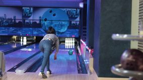 Woman in club for bowling is throwing ball stock video