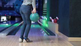 Woman in club for bowling is throwing ball stock footage