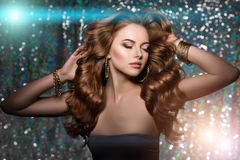 Woman club lights party background. Dancing girl Long hair. Wave Stock Photography