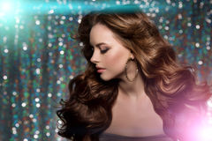 Woman club lights party background Dancing girl Long hair. Waves. Curls Updo Hairstyle. Hair Salon Fashion model with shiny healthy hair with luxurious haircut Royalty Free Stock Photo