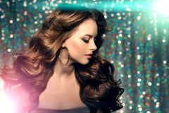 Woman club lights party background Dancing girl Long hair. Waves Royalty Free Stock Image