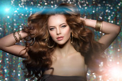 Woman club lights party background Dancing girl Long hair. Waves Stock Photo
