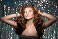 Woman club lights party background Dancing girl Long hair. Waves Royalty Free Stock Photography