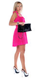 Woman with clutch bag Stock Images