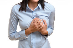 Woman clutching her breast in pain Stock Photos
