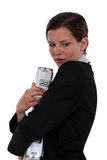 Woman clutching briefcase Stock Images