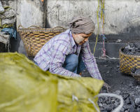 Woman with coal Royalty Free Stock Image