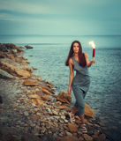 Woman in coast ocean with fire fans. Pretty woman in coast ocean with fire fans Stock Image