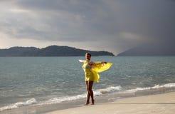 Woman at coast of the sea Royalty Free Stock Image