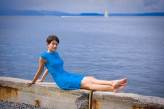 Woman on coast of sea Royalty Free Stock Photos