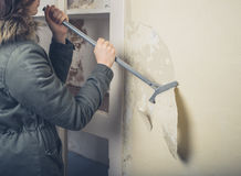 Woman in coast stripping wallpaper Stock Images